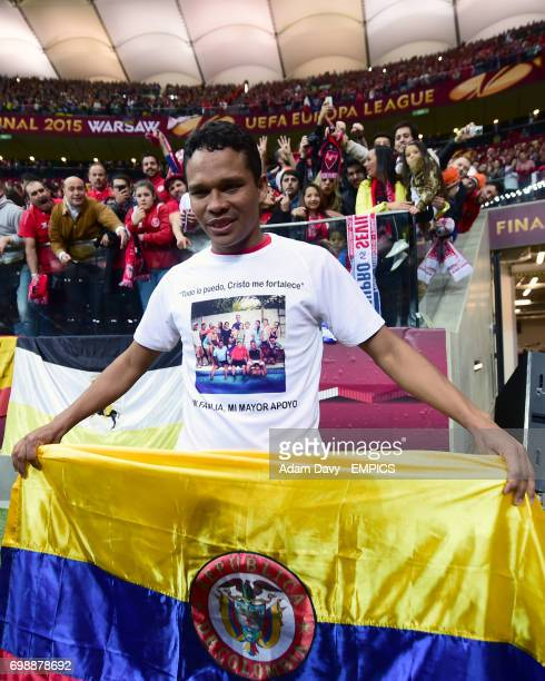 Sevilla's Carlos Bacca celebrates at the end of the game