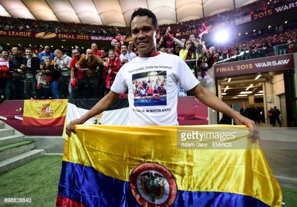 Sevilla's Carlos Bacca celebrates winning the UEFA Europa League by holding a Colombian flag