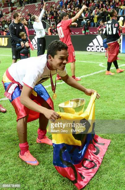 Sevilla's Carlos Bacca celebrates with the Trophy at the end of the game