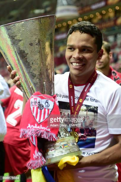 Sevilla's Carlos Bacca holds the UEFA cup