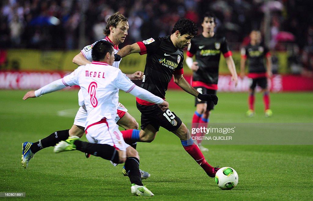 Sevilla's Chilean midfielder Gary Medel (L) vies with Atletico Madrid's Brazilian forward Diego da Silva Costa (R) during the Copa del Rey (King's Cup) semi-final second leg football match Sevilla FC vs Atletico de Madrid at the Ramon Sanchez Pizjuan staduim in Sevilla on February 27, 2013.