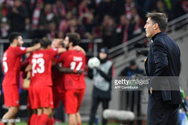 Sevilla's coach from Argentina Eduardo Berizzo looks on as Spartak Moscow's players celebrate during the UEFA Champions League Group E football match...
