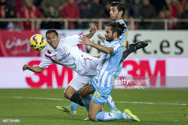 Sevilla's Colombian forward Carlos Bacca vies with Malaga's Argentinian defender Marcos Alberto Angeleri and defender Miguel Torres during the...