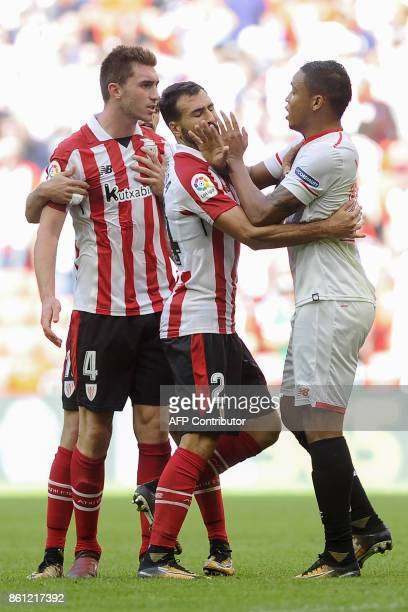 Sevilla's Colombian forward Luis Muriel argues with Athletic Bilbao's French defender Aymeric Laporte during the Spanish league football match...