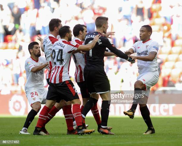 Sevilla's Colombian forward Luis Muriel argues with Athletic Bilbao's players at the end of the Spanish league football match Athletic Club Bilbao vs...
