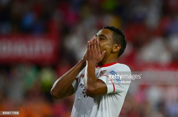 Sevilla's Colombian forward Luis Muriel reacts during the Spanish league football match Sevilla FC vs Espanyol at the Ramon SánchezPizjuan in Sevilla...