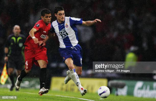 Sevilla's Daniel Alves and Espanyol's Albert Riera battle for the ball