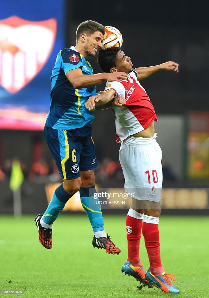 Sevilla's Daniel Carrico and Standard's Igor de Camargo fight for the ball during their third group stage match between Belgian first division soccer...