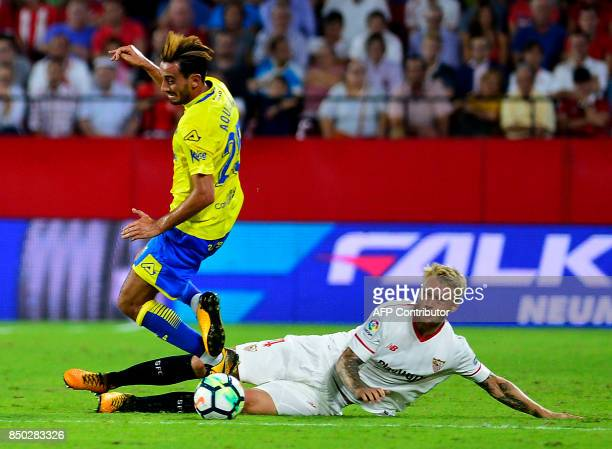 Sevilla's Danish defender Simon Kjaer vies with Las Palmas' forward Asdrubal Padron during the Spanish league football match Sevilla FC against UD...