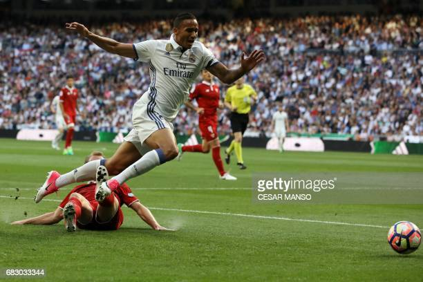 Sevilla's Danish midfielder Michael KrohnDehli vies with Real Madrid's Brazilian defender Danilo during the Spanish league football match Real Madrid...