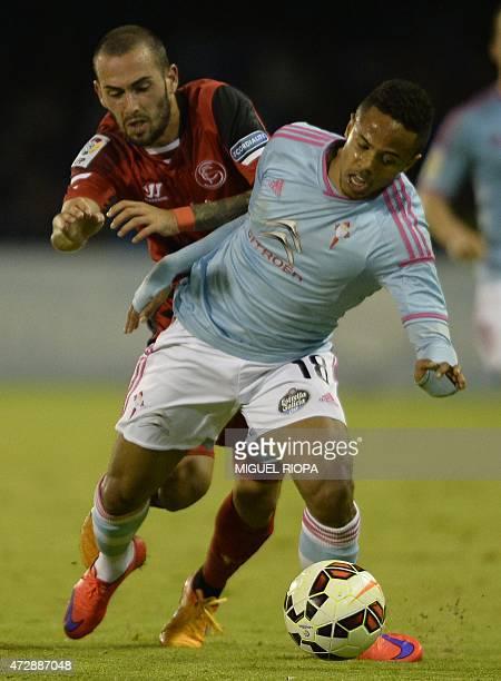 Sevilla's defender Alejandro Arribas vies with Celta's Belgian forward Theo Bongonda during the Spanish league football match RC Celta de Vigo vs...