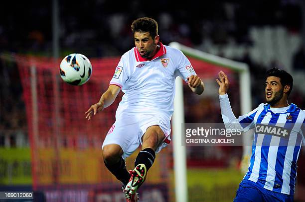 Sevilla's defender Coke vies with Real Sociedad's Mexican forward Carlos Vela during the Spanish league football match Sevilla FC vs Real Sociedad at...