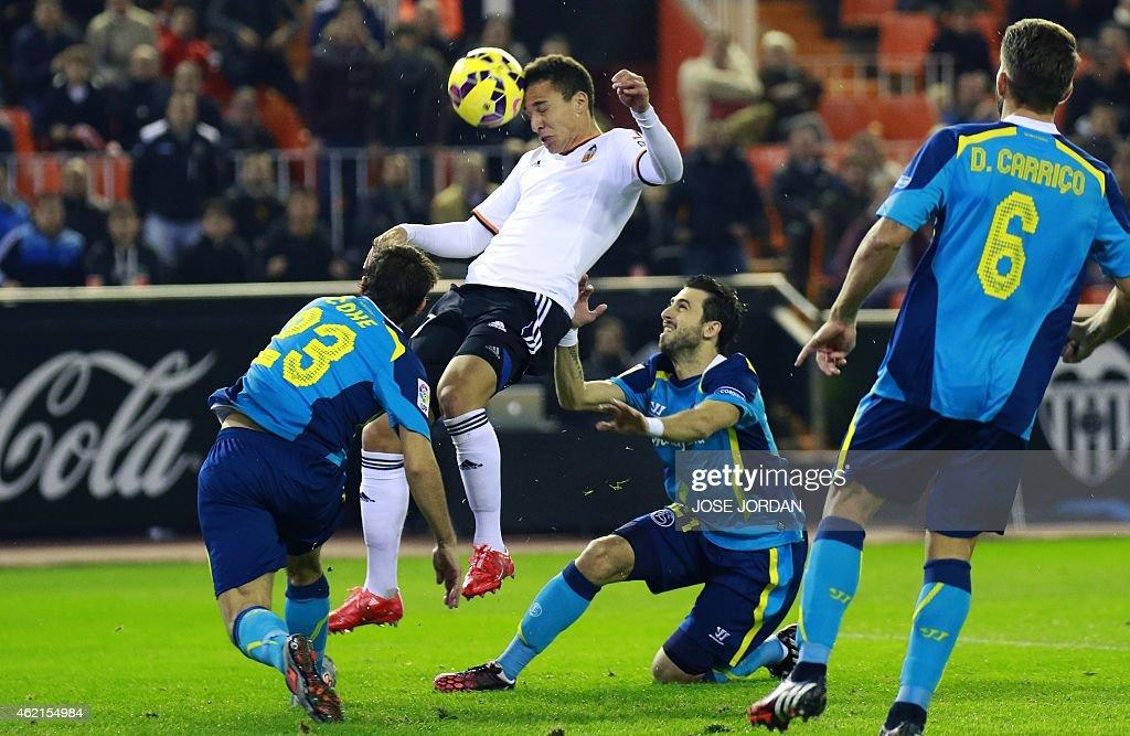 Sevilla's defender Coke (L) vies with Valencia's Argentinian midfielder Rodrigo de Paul (2nd L) during the Spanish league football match Valencia vs Sevilla at Mestalla stadium in Valencia on January 25, 2015.