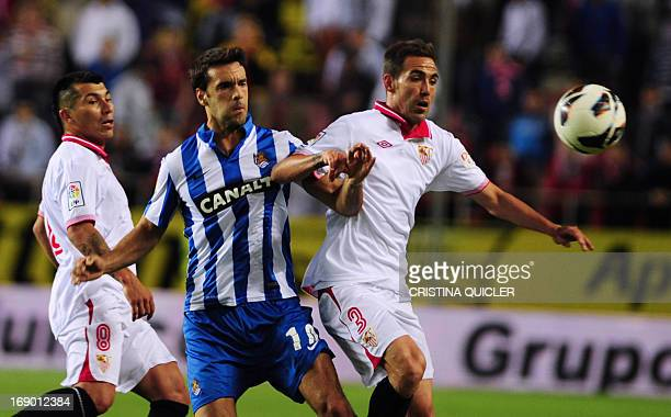 Sevilla's defender Fernando Navarro vies with Real Sociedad's midfielder Xabi Prieto during the Spanish league football match Sevilla FC vs Real...