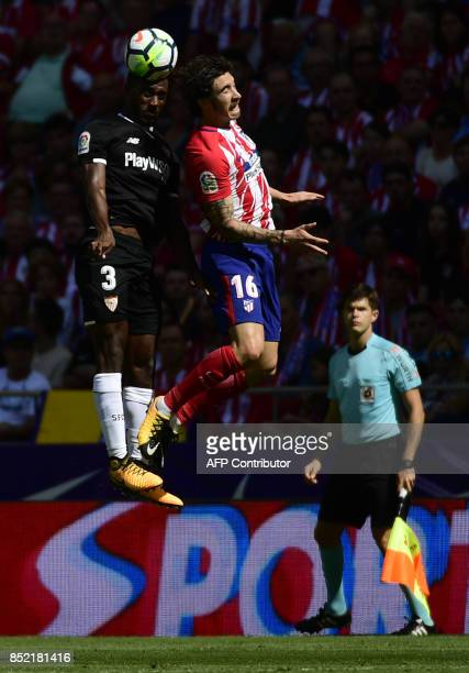 Sevilla's defender from France Lionel Carole vies with Atletico Madrid's defender from Croatia Sime Vrsaljko during the Spanish league football match...