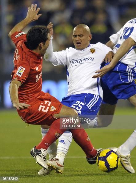 Sevilla's defender Lolo vies with Zaragoza´s Leo Ponzio Zaragoza's Humberto Suazo of Chile during the Spanish League football match on February 7 at...
