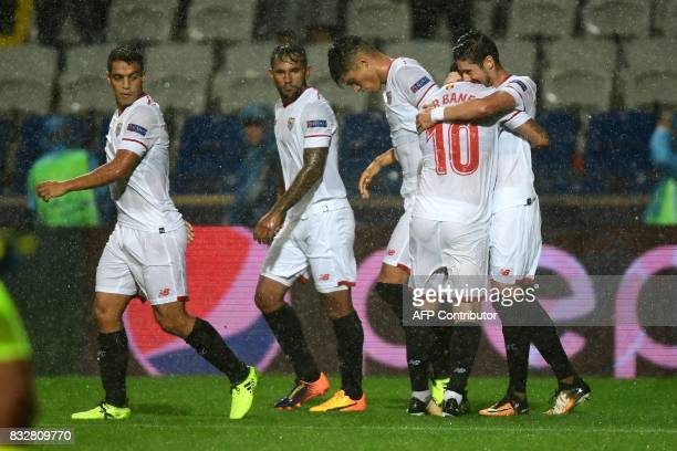 Sevilla's defender Sergio Escudero celebrates with his teammates after scoring a goal during the UEFA Champions League playoff first leg football...