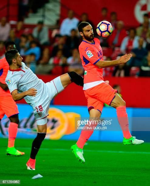Sevilla's defender Sergio Escudero vies with Granada's defender David Rodriguez Lomban during the Spanish league football match Sevilla FC vs Granada...