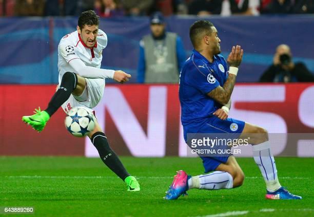 Sevilla's defender Sergio Escudero vies with Leicester City's midfielder Marc Albrighton during the UEFA Champions League round of 16 second leg...