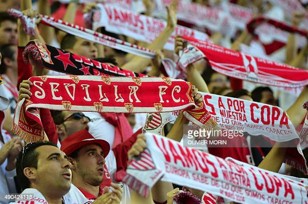 Sevilla's fans cheer before the UEFA Europa league final football match between Benfica and Sevilla on May 14 2014 at the Juventus stadium in Turin...