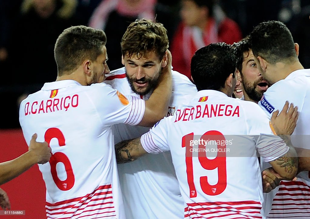 Sevilla's forward Fernando Llorente celebrates his second goal with teammates during the UEFA Europa League Round of 32 first leg football match...
