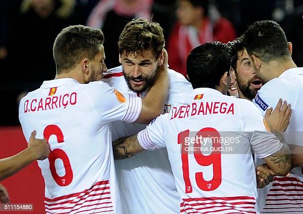 Sevilla's forward Fernando Llorente celebrates his second goal with teammates during the UEFA Europa League Round of 32 first leg football match...