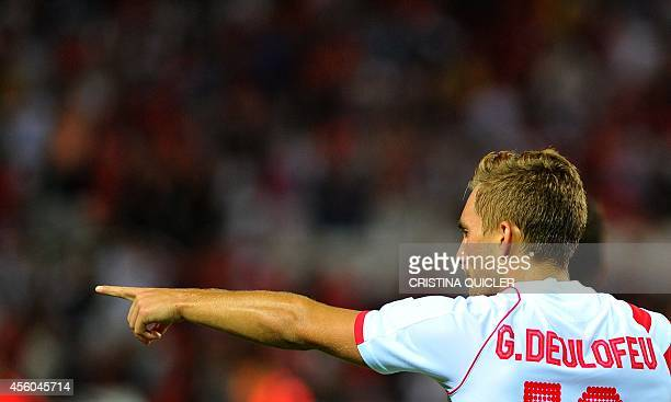 Sevilla's forward Gerard Deulofeu celebrates after scoring during the Spanish league football match Sevilla FC vs Real Sociedad at the Ramon Sanchez...