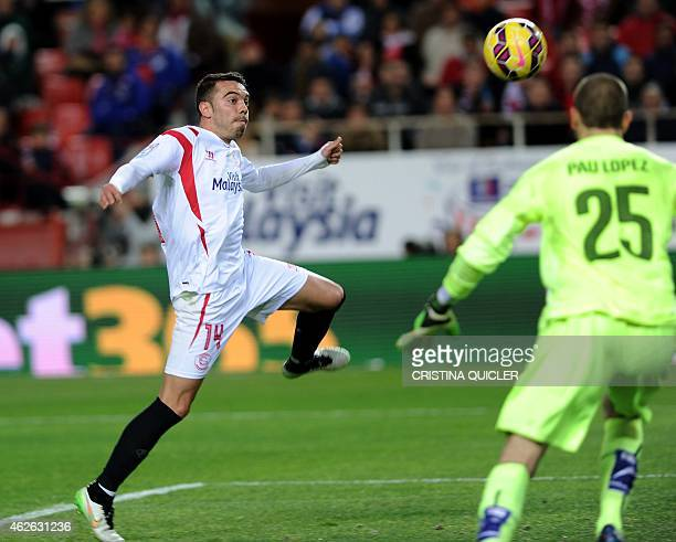 Sevilla's forward Iago Aspas vies with Espanyol's goalkeeper Pau Lopez during the Spanish league football match Sevilla FC vs RCD Espanyol at the...