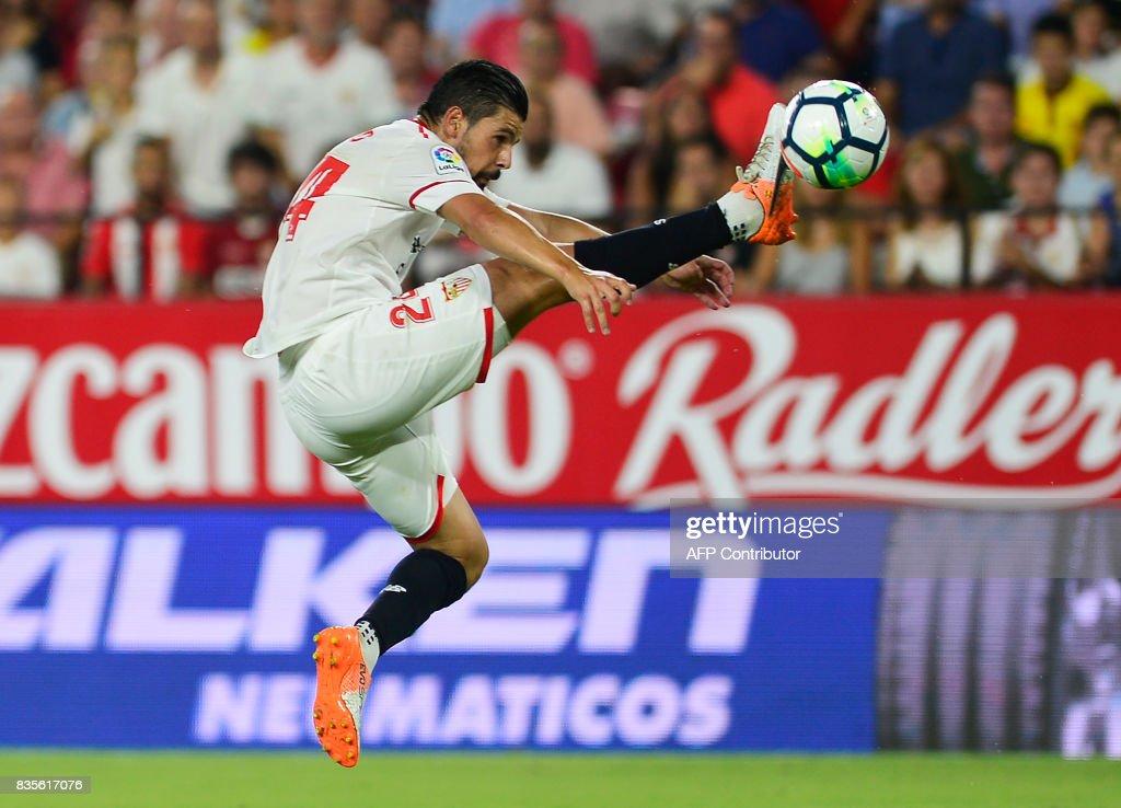 Sevilla's forward Nolito (C) kicks the ball during the Spanish league football match Sevilla FC vs Espanyol at the Ramon Sanchez-Pizjuan in Sevilla on August 19, 2017. QUICLER