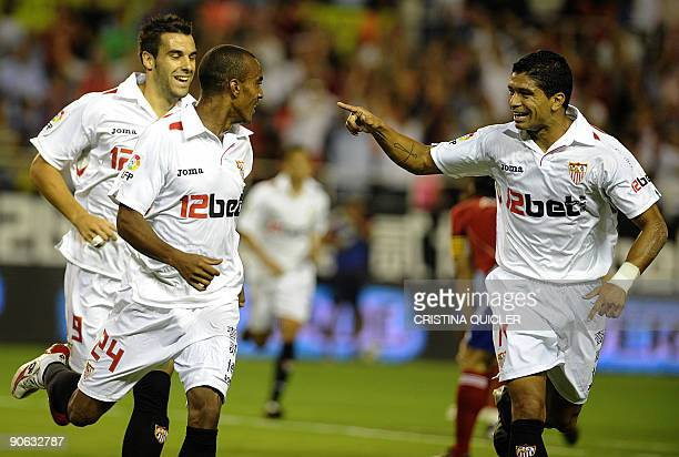 Sevilla's French defender Abdoulay Konko celebrates after scoring with Sevilla's Brazilian midfielder Renato and Sevilla's midfielder Álvaro Negredo...