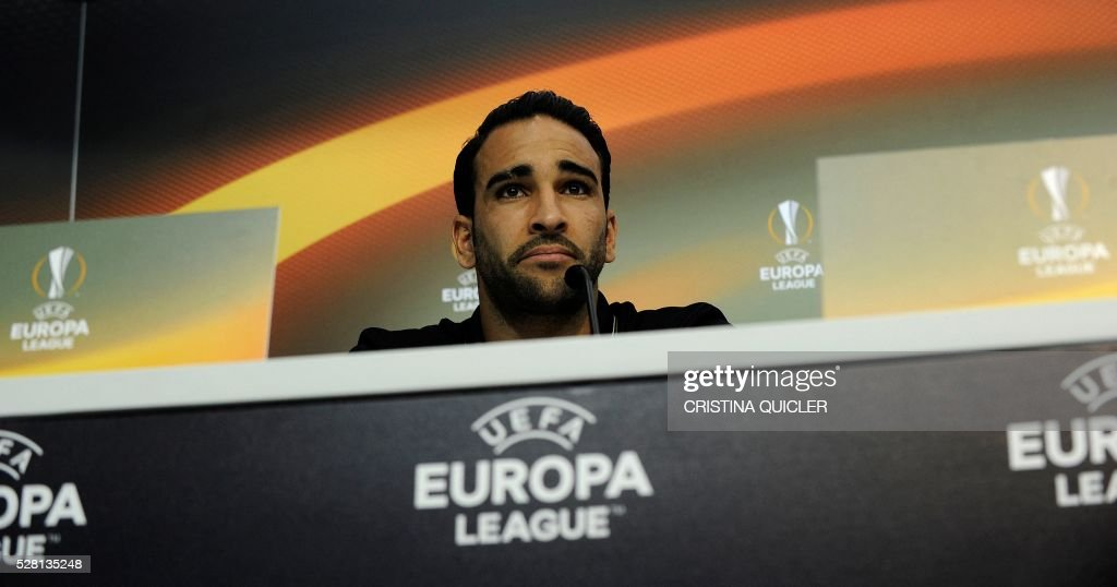 Sevilla's French defender Adil Rami looks on during a press conference on May 4, 2016 on the eve of the UEFA Europa League semi-final second leg football match Sevilla FC vs Shakhtar Donetsk at the Ciudad Deportiva in Sevilla. / AFP / CRISTINA