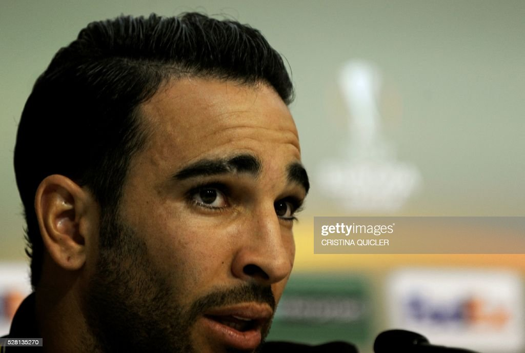 Sevilla's French defender Adil Rami speaks during a press conference on May 4, 2016 on the eve of the UEFA Europa League semi-final second leg football match Sevilla FC vs Shakhtar Donetsk at the Ciudad Deportiva in Sevilla. / AFP / CRISTINA