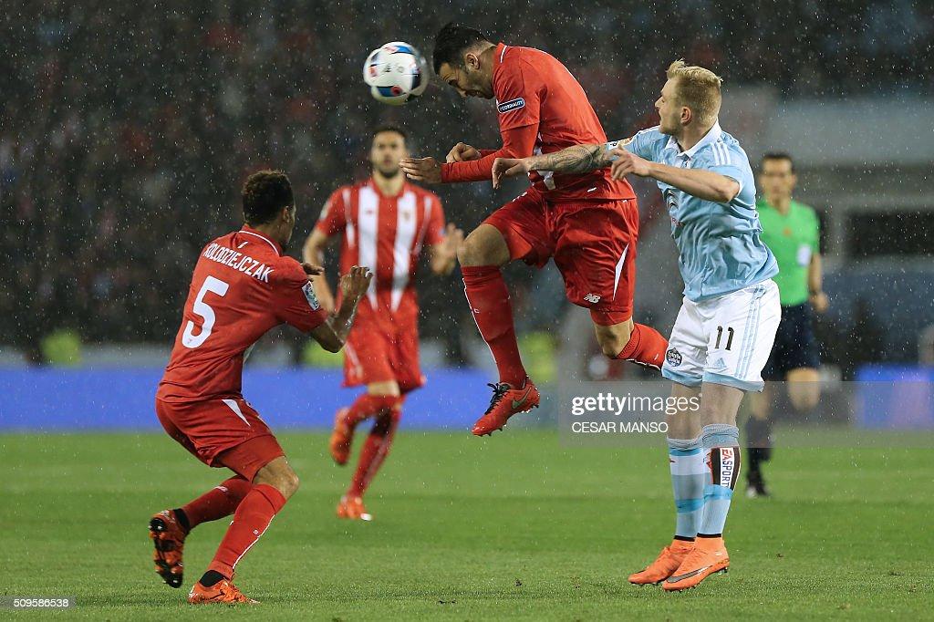 Sevilla's French defender Adil Rami vies with Celta Vigo's Swedish forward John Guidetti during the Spanish Copa del Rey semifinal second leg...