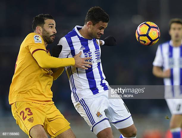 Sevilla's French defender Adil Rami vies with Real Sociedad's Brazilian forward Willian Jose during the Spanish league football match Real Sociedad...