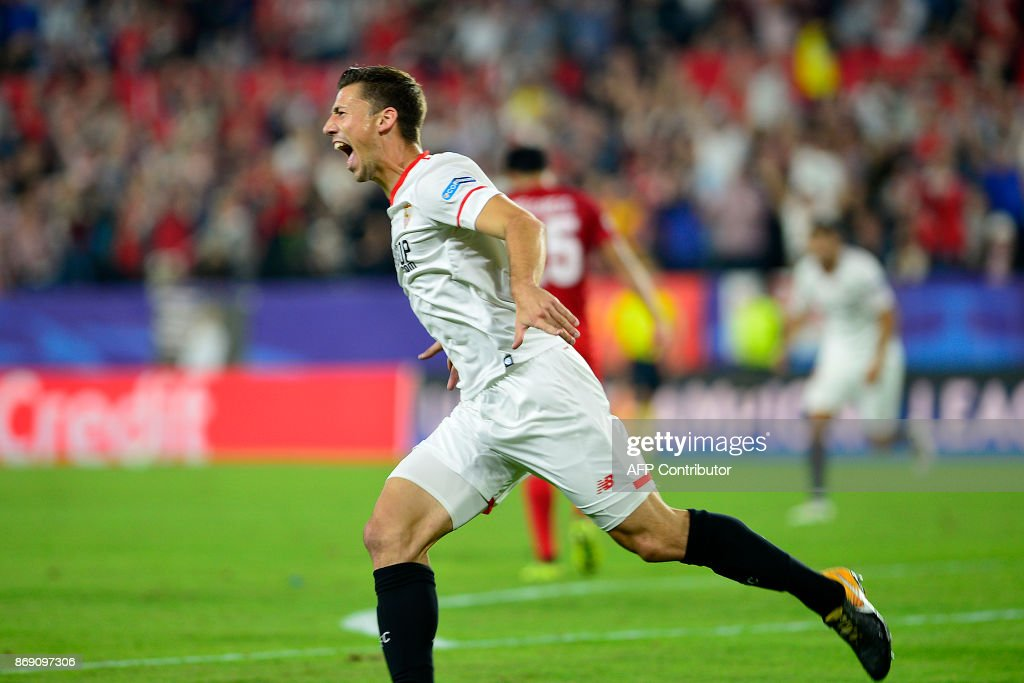 Sevilla's French defender Clement Lenglet celebrates after scoring a goal during the UEFA Champions League group E football match between Sevilla and Spartak Moscow at Sanchez Pizjuan Stadium in Sevilla on November 1, 2017. /