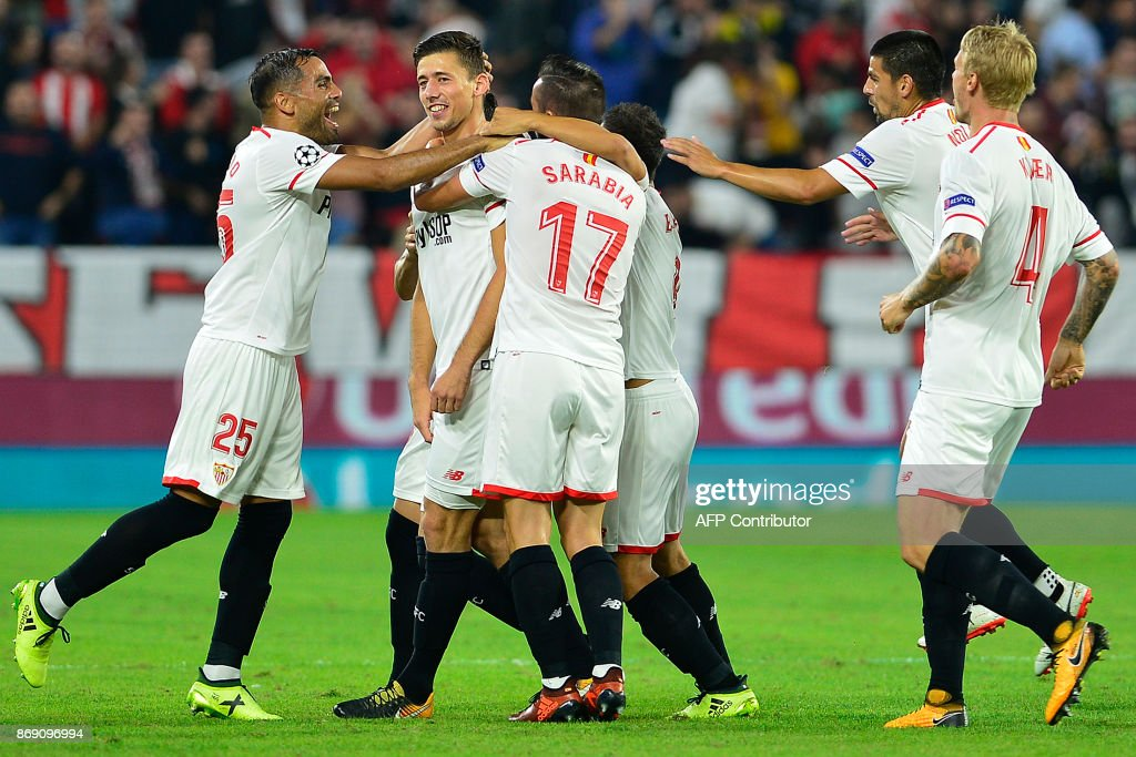 Sevilla's French defender Clement Lenglet (2nd-L) celebrates with teammates after scoring a goal during the UEFA Champions League group E football match between Sevilla and Spartak Moscow at Sanchez Pizjuan Stadium in Sevilla on November 1, 2017. /