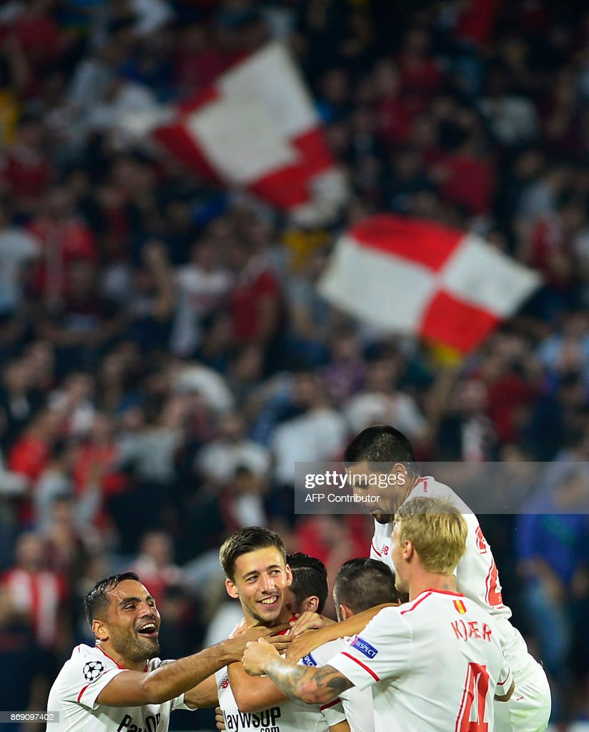 Sevilla's French defender Clement Lenglet (C) celebrates with teammates after scoring a goal during the UEFA Champions League group E football match between Sevilla and Spartak Moscow at Sanchez Pizjuan Stadium in Sevilla on November 1, 2017. /