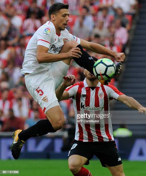Sevilla's French defender Clement Lenglet challenges Athletic Bilbao's Spanish forward Aritz Aduriz during the Spanish league football match Athletic...