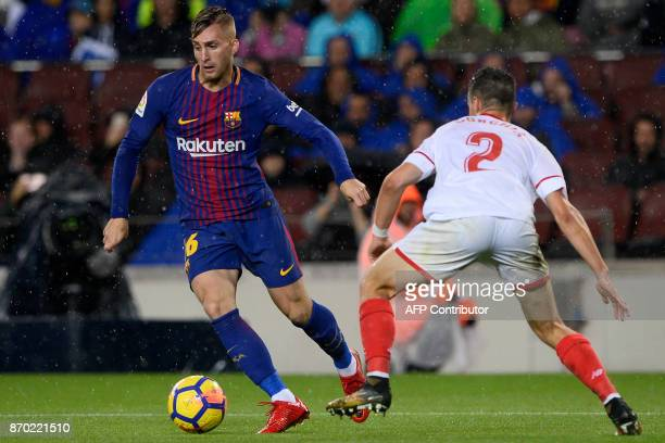 Sevilla's French defender Sebastien Corchia challenges Barcelona's Spanish forward Gerard Deulofeu during the Spanish league football match FC...