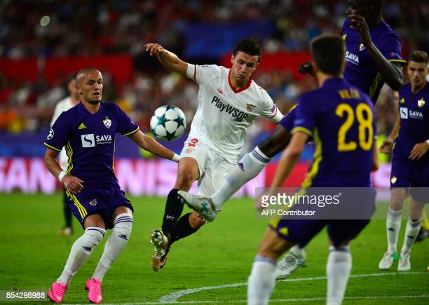 Sevilla's French defender Sebastien Corchia vies with Maribor's Albanian midfielder Valon Ahmedi during the UEFA Champions League Group E football...