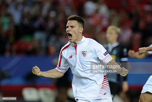 Sevilla's French forward Kevin Gameiro celebrates a goal during the UEFA Champions League group D football match Sevilla FC vs VfL Borussia...