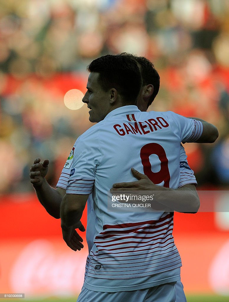 Sevilla's French forward Kevin Gameiro celebrates after scoring during the Spanish league football match FC Sevilla vs UD Las Palmas at the Ramon Sanchez Pizjuan stadium in Sevilla on February 14, 2016. Sevilla won 2-0. / AFP / CRISTINA QUICLER