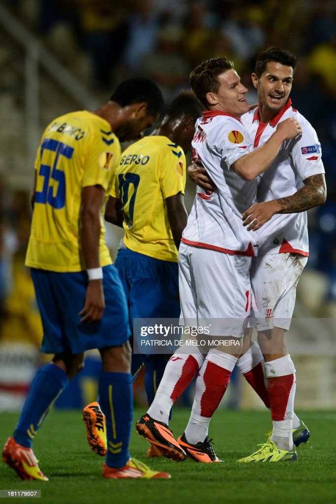Sevilla's French forward Kevin Gameiro (2nd R) celebrates with his teammate Sevilla's midfielder Victor Machin (R) after scoring during the UEFA Europa League, group H, football match Estoril vs Sevilla at the Antonio Coimbra da Mota stadium in Estoril on September 19, 2013.