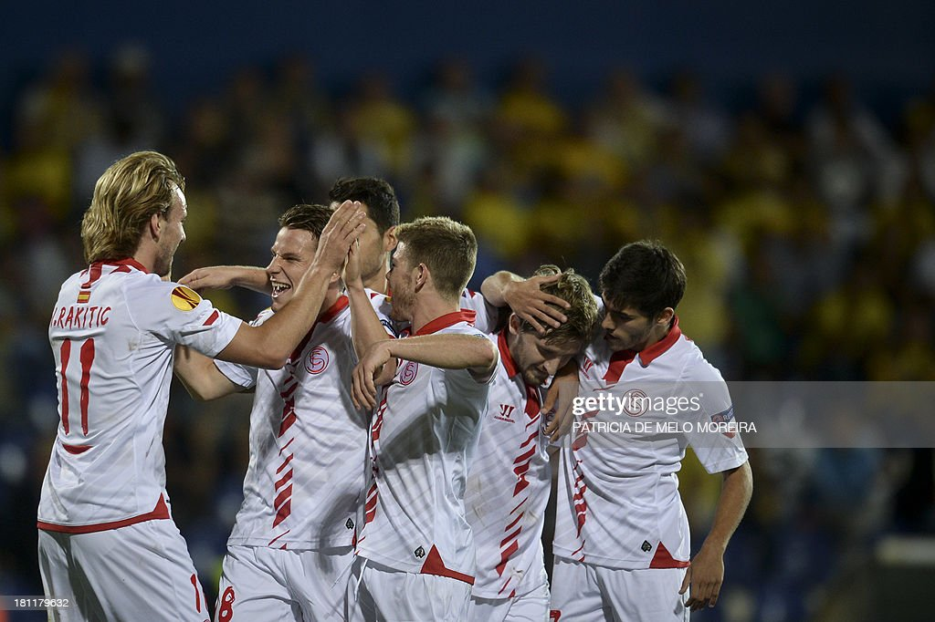 Sevilla's French forward Kevin Gameiro (2nd L) celebrates with his teammates after scoring during the UEFA Europa League, group H, football match Estoril vs Sevilla at the Antonio Coimbra da Mota stadium in Estoril on September 19, 2013. Sevilla won the match 2-1.