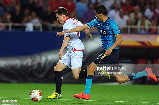 Sevilla's French forward Kevin Gameiro vies with Porto's Mexican defender Diego Reyes during the UEFA Europa League quarterfinal second leg football...