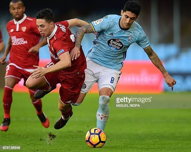Sevilla's French forward Samir Nasri vies with Celta Vigo's Chilean midfielder Pablo Hernandez during the Spanish league football match RC Celta de...
