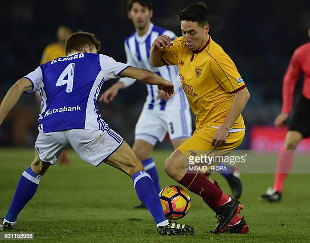 Sevilla's French forward Samir Nasri vies with Real Sociedad's midfielder Asier Illarramendi during the Spanish league football match Real Sociedad...