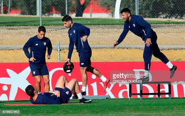 Sevilla's French forward Wissam Ben Yedder and Sevilla's Argentinian midfielder Ever Banega take part in a training session at the Ciudad Deportiva...