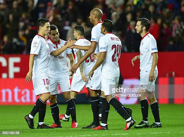 Sevilla's French forward Wissam Ben Yedder celebrates a goal with teammates during the Spanish league football match Sevilla FC vs Malaga CF at the...