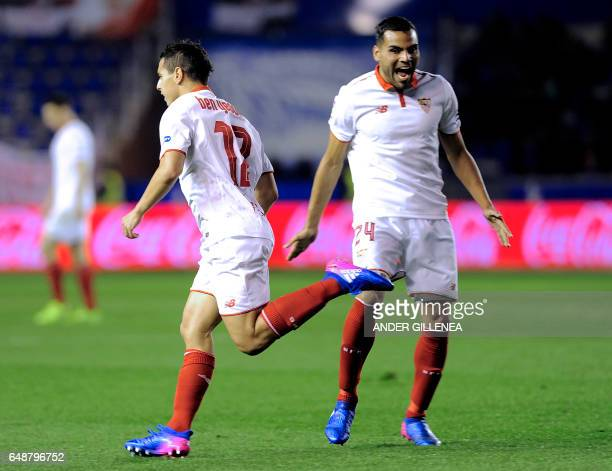 Sevilla's French forward Wissam Ben Yedder celebrates after scoring his team's first goal beside Argentinian defender Gabriel Mercado during the...